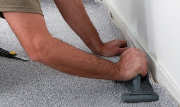 Carpet Installation - seam roller | Jack's Tile And Carpet