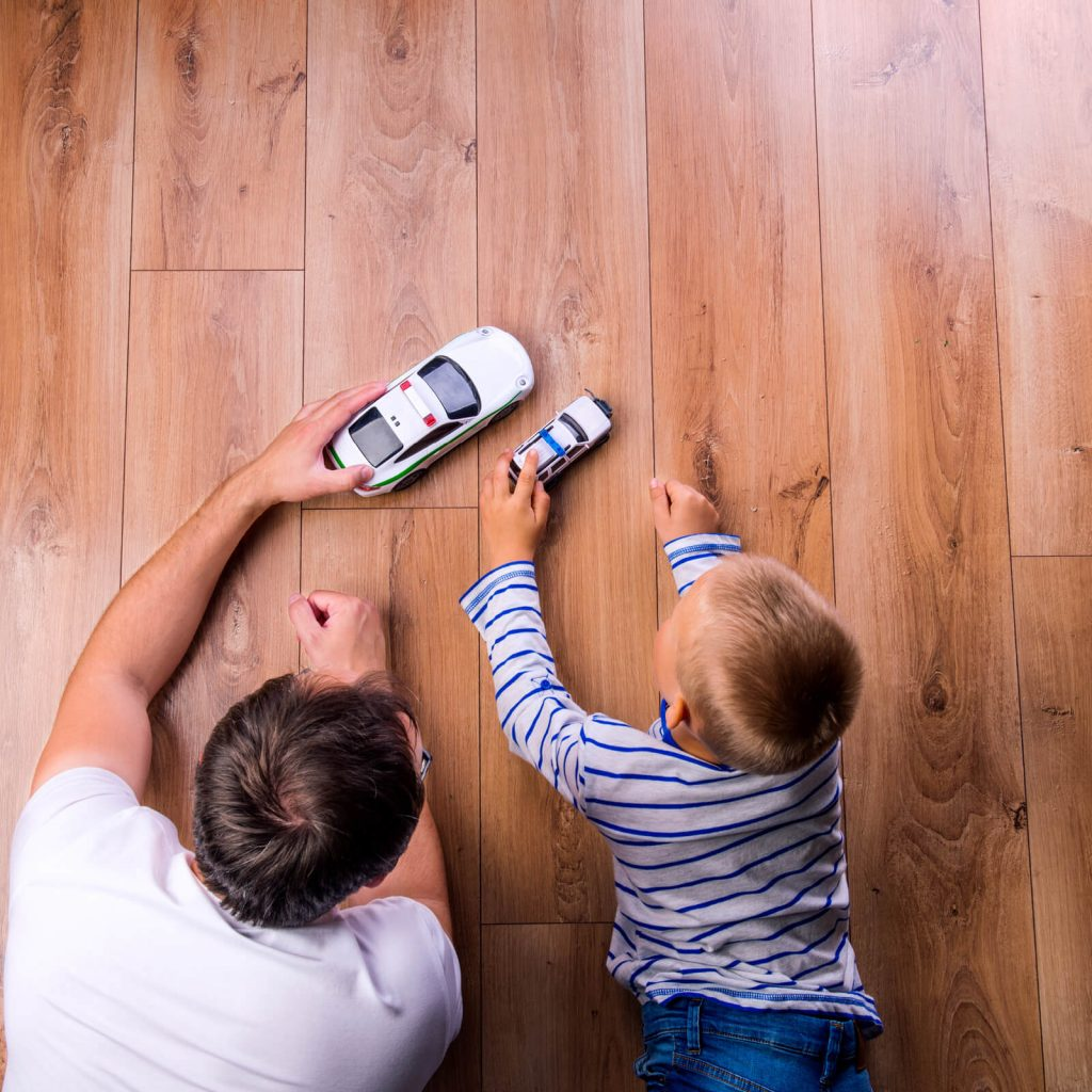 Father with kid playing with toycar | Jack's Carpet And Tile