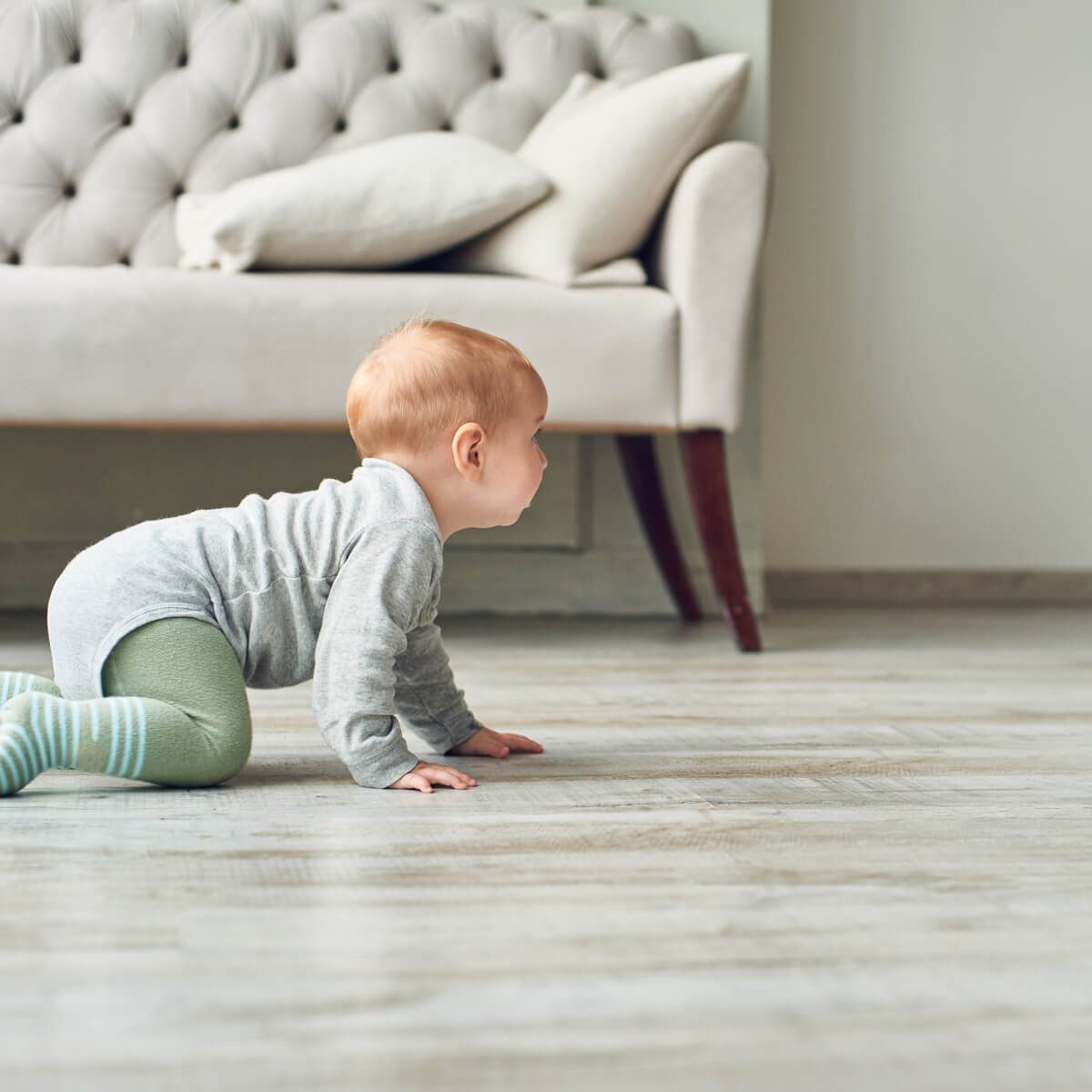 Baby on luxury vinyl floor | Jack's Tile And Carpet