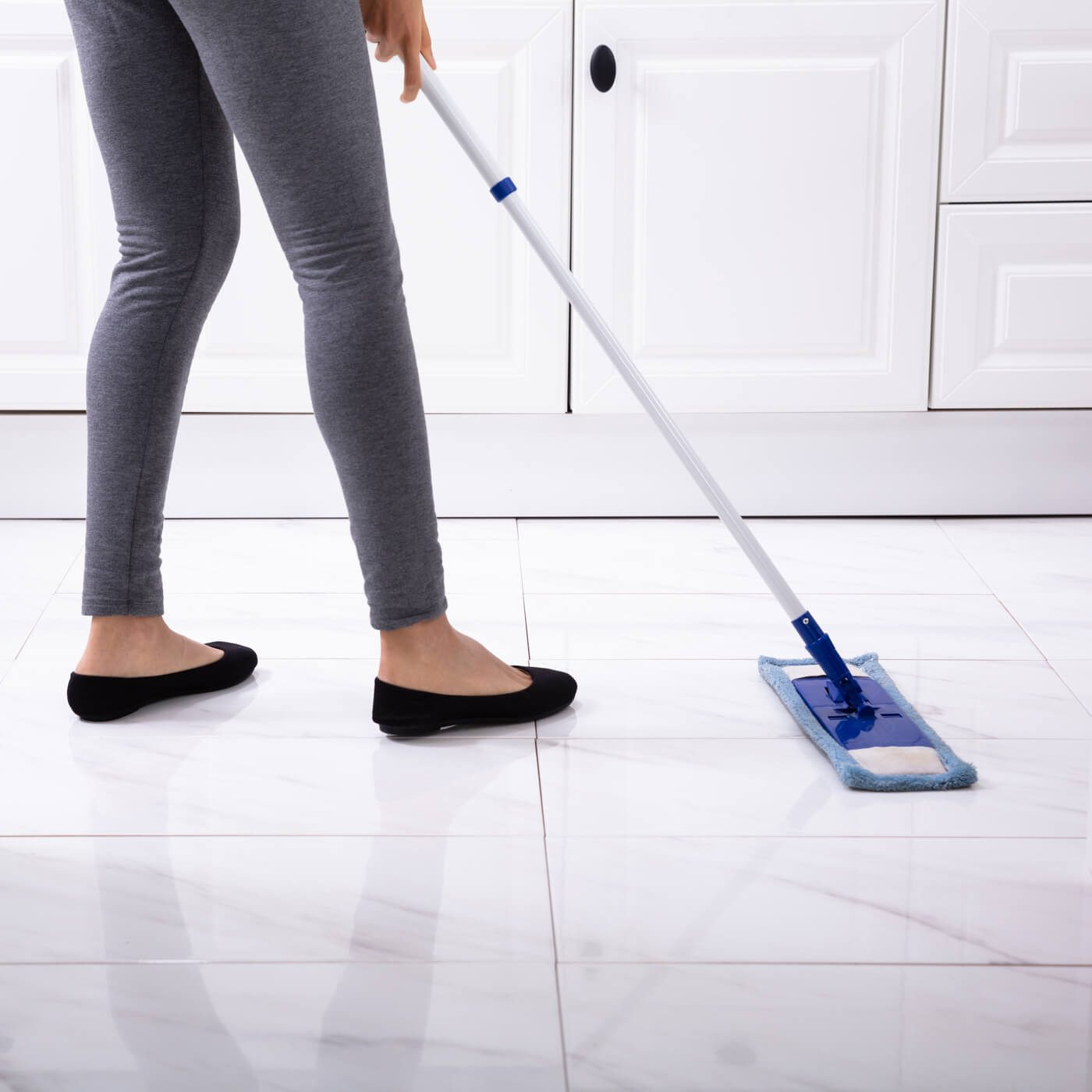 Cleaning tile by sweeping | Jack's Tile And Carpet