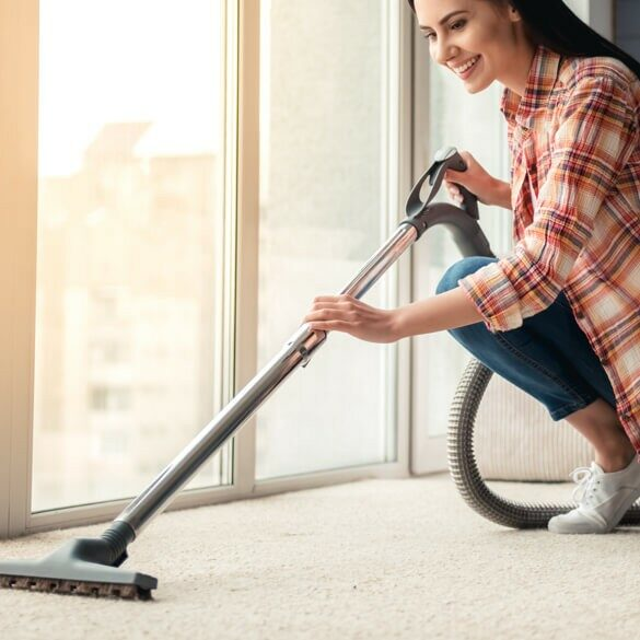 woman cleaning carpet | Jack's Tile And Carpet